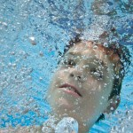 A close up of Bruce's son underwater.