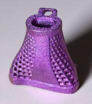 3d printed titanium vertebrae. It is painted purple.