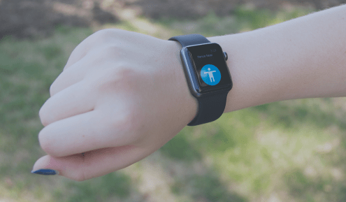 """photo showing """"fence near"""" notification on the BeAware app on the smart watch. A notification on the BeAware app appears when the user approaches an obstacle."""