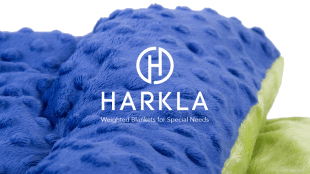 image of a weighted blanket colored blue and yellow with harkla logo displayed in the center.