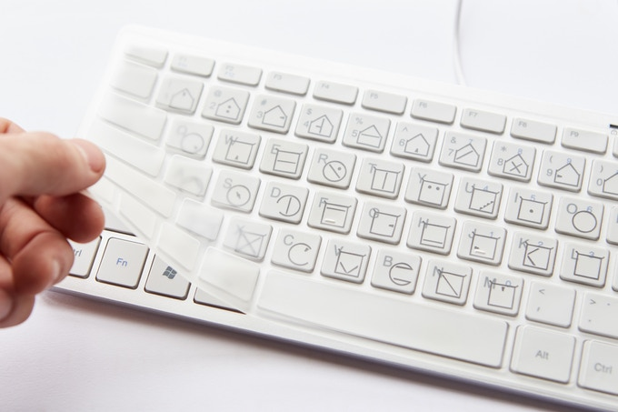 ELIA tactile keyboard cover shown laid over a regular keyboard.