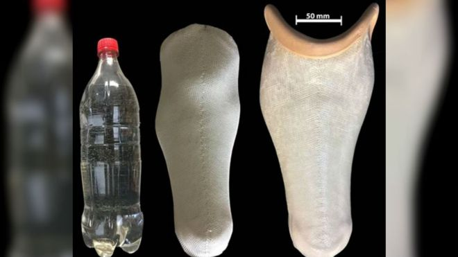 photo shows a plastic bottle next to a prosthetic socket made from polyester yarn from ground plastic bottles