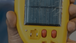 close up of deaftronics' solar charger for hearing aids