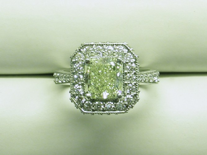 custom ring with a fancy yellow diamond