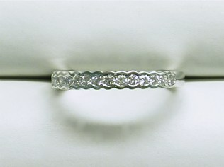 wb-1560 Channel set diamond wedding band with a scalloped edge, 18K white gold