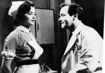 Nurse Jill Craig (Anne Brooks) talks to Dr. Nick Williams (David Butler) in an off-duty moment.