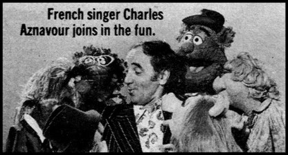 French singer Charles Aznavour joins in the fun.