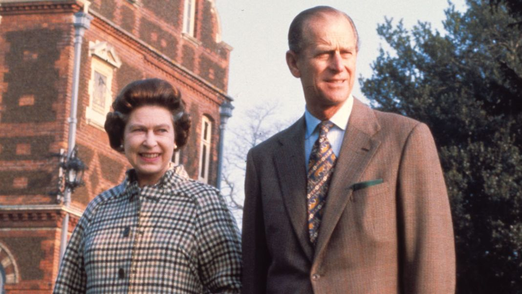 Britain's Queen Elizabeth II and the Duke of Edinburg, Prince Philip, pose in the grounds of Sandringham House in 1982