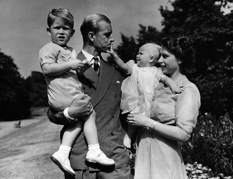 An old photo of the Queen and Prince Philip with their children