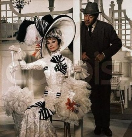 Original caption: Publicity handout from the 1964 film, directed by George Cukor, starring Audrey Hepburn as Eliza Doolittle, and Rex Harrison as Professor Henry Higgins. ca. 1964