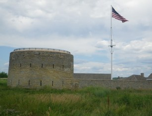 The United States flag flies over Historic Fort Snelling in Minneapolis, Minn. At left is the fort's Round Tower. (c) J.S. Reinitz 2014