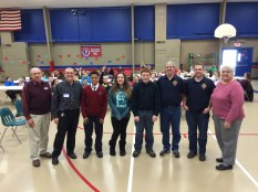 Saint Catherine of Siena Council 6890 Past Grand Knight John Walsh, Assumption Council's Grand Knight Ray Iacovone, third place winner Kyree Myers, second place winner Michelle Laganella, first place winner Ben Jefferis, Warden Al Duaime, Doug Miedel, and Saint Bridget parishioner Ines Terway.