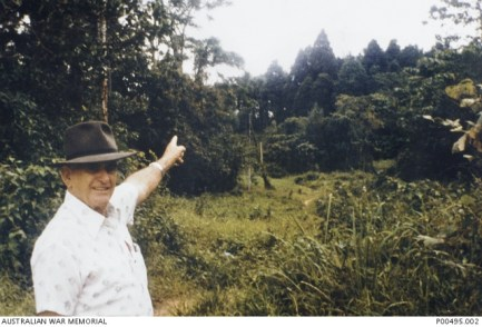 OWEN CAMPBELL, SURVIVOR OF THE BORNEO DEATH MARCHES, POINTS OUT THE BOILER HOUSE AREA AT THE SITE OF FORMER SANDAKAN MILE 8 PRISONER OF WAR CAMP, STARTING POINT OF THE 1945 POW DEATH MARCHES.