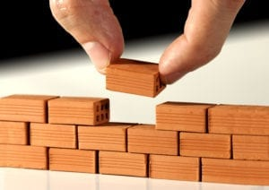 Small blocks stacked up represent dental front office systems.