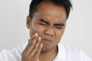 A patient has a toothache. He calls the dental office despite his account balance.