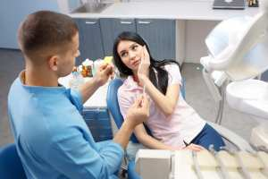 A new patient can be scheduled for an emergency exam first. A full comprehensive exam can be scheduled another time.
