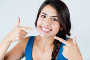 Smiling at with your dental patients will increase case acceptance in your dental office.