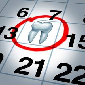 Confirming Dental Appointments Well Is Reminding Patients of Their Scheduled Dental Appointments. A Tooth on a Calendar Marks a Dental Appointment.