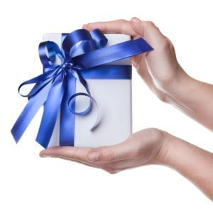 My Free Gift Will Help The Dental Office With Seasonal Dental Practice Management. A White Box With A Blue Bow Is Being Held Out To You.