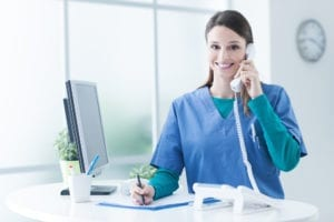 The dental front office greets patients on the phone and in person