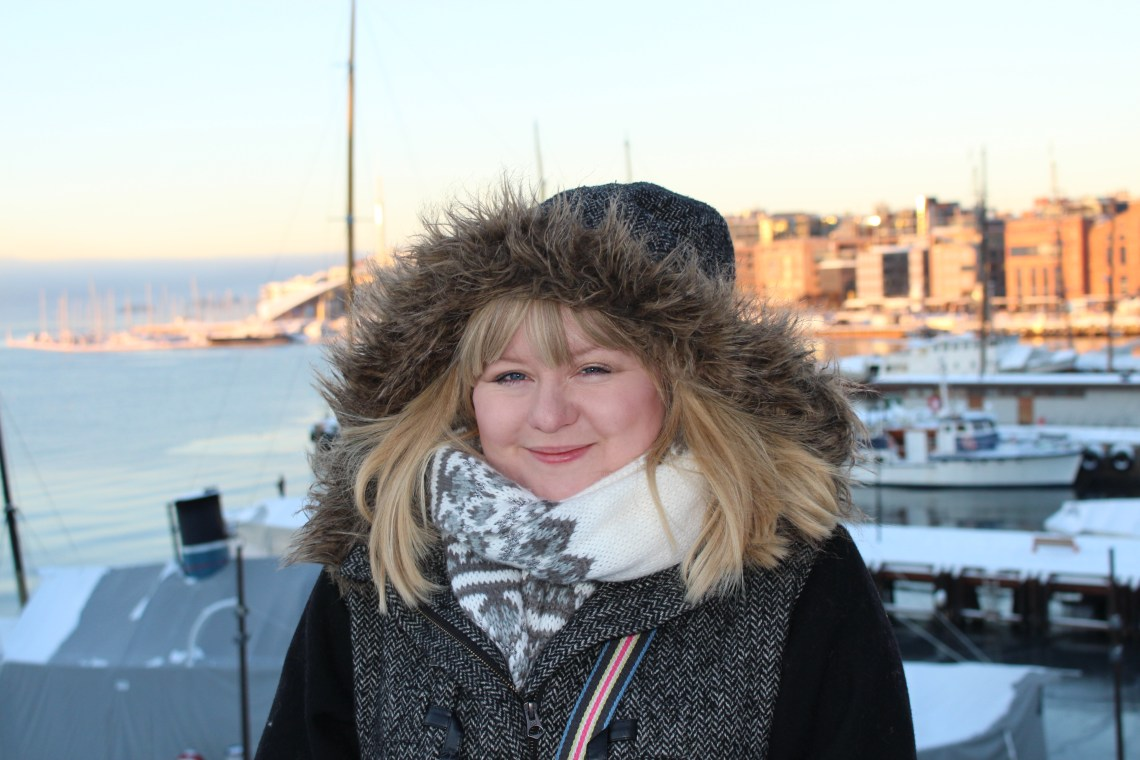 Visiting Oslo in January - smiling woman with big furry hood