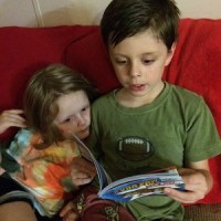 Reading a Scholastic Branches book together before bed.