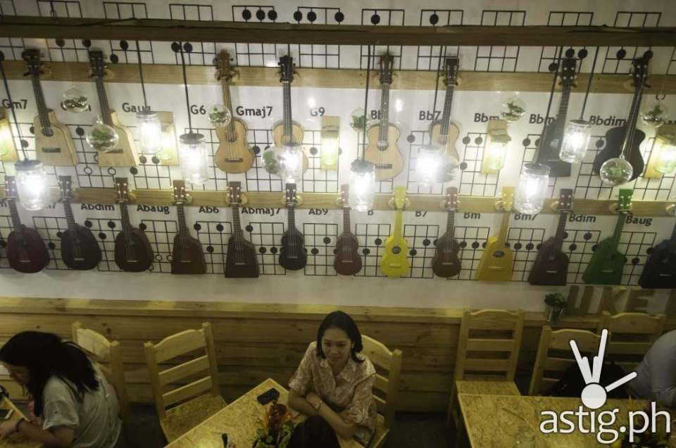 HUNI-brand ukeleles adorn the walls of Uke Box Caffe in Libis Quezon City