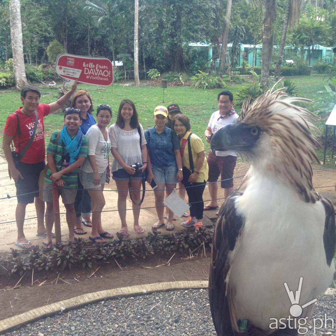 A Philippine eagle name fighter does a selfie with guests at the Philippine Eagle Center