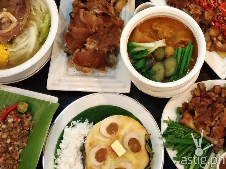 Clockwise from top-left Bulalo with Mais, Original Crispy Pata, Kare-Kare, Patang Demonyo, Crispy Pata, Prichon Pata, Bibingka, Sisig ni Mely - Mangan Restaurant Glorietta 2