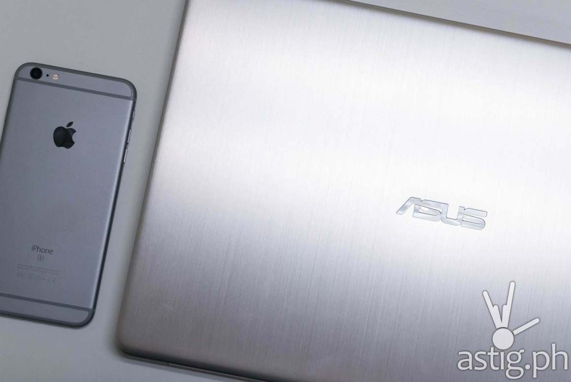 ASUS VivoBook S15 size compared to the iPhone Plus