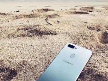OPPO F9 Jade Green on sand