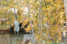 Copper Garden Sculpture near pond
