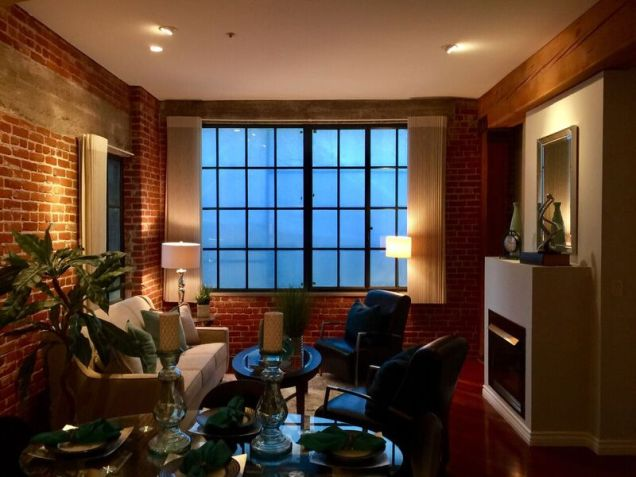 Living room staging with brick and beige accents