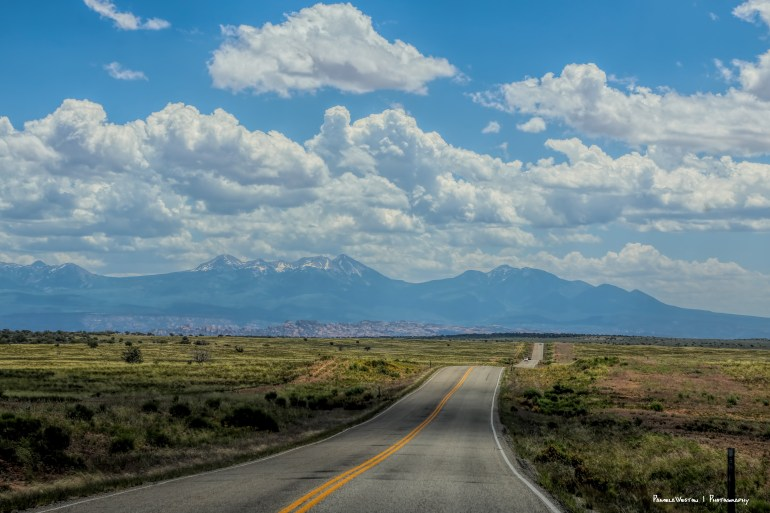Driving on Utah 313 looking West towards the 12,000' La Sal Mountains