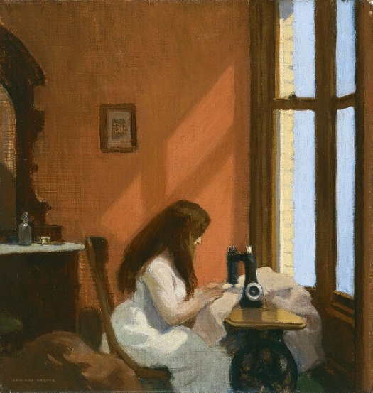 Saturn in Virgo: Girl is sitting at a sewing machine, in front of a big window in a brown room.