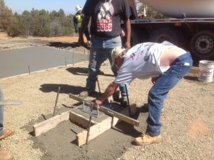 Finishing off cement for pier footing