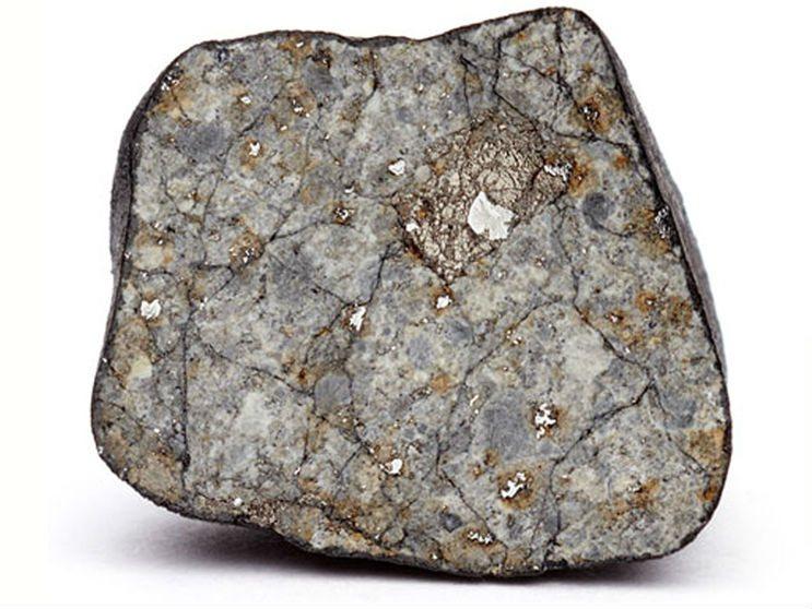 Meteorito com cerca de 4 centímetros de diâmetro. Crédito: Science/AAAS
