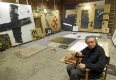 Antoni Tapies walking around his studio waiting for feeling like making the next move.