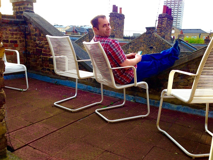 Micah on the rooftop balcony of our Roupell Street Airbnb