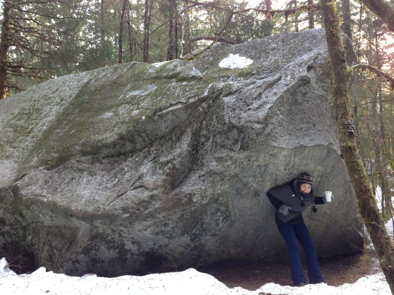 Sophie uses coffee strength to hold up a cabin sized rock