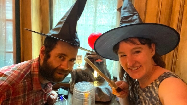 Ready to mix potions at The Cauldron with hats and wand