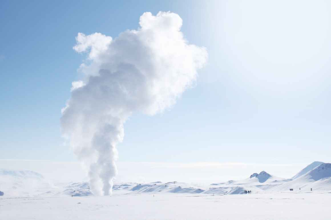 smoke rising from snow covered field