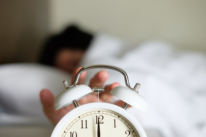 hand-hitting-snooze-button-Getty