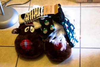 It's cold, so I got reindeer slippers. Loads of socks, a scarf, and my all time need for a bad hair day, a knit cap.