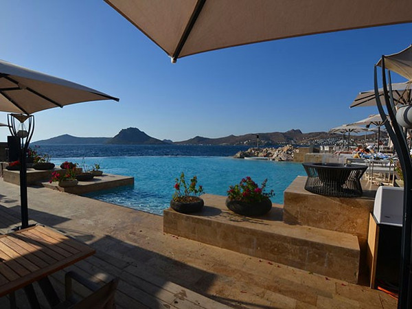 Relax in the Palmarina infinity pool at the Lotus Beach Club