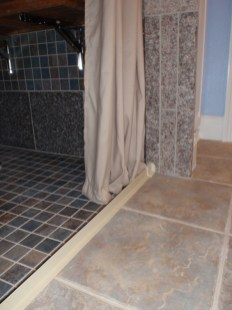 Tiled Shower With a barrier free entry. Water can stay in while allowing a smooth transition for wheels.