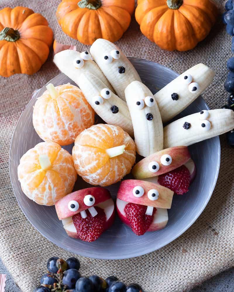 plate of easy Halloween snack ideas, tangerine pumpkin