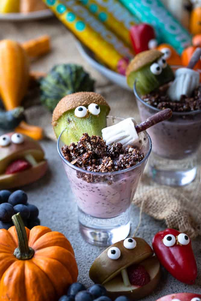 Halloween chia cups with kiwi monsters and a witches broom