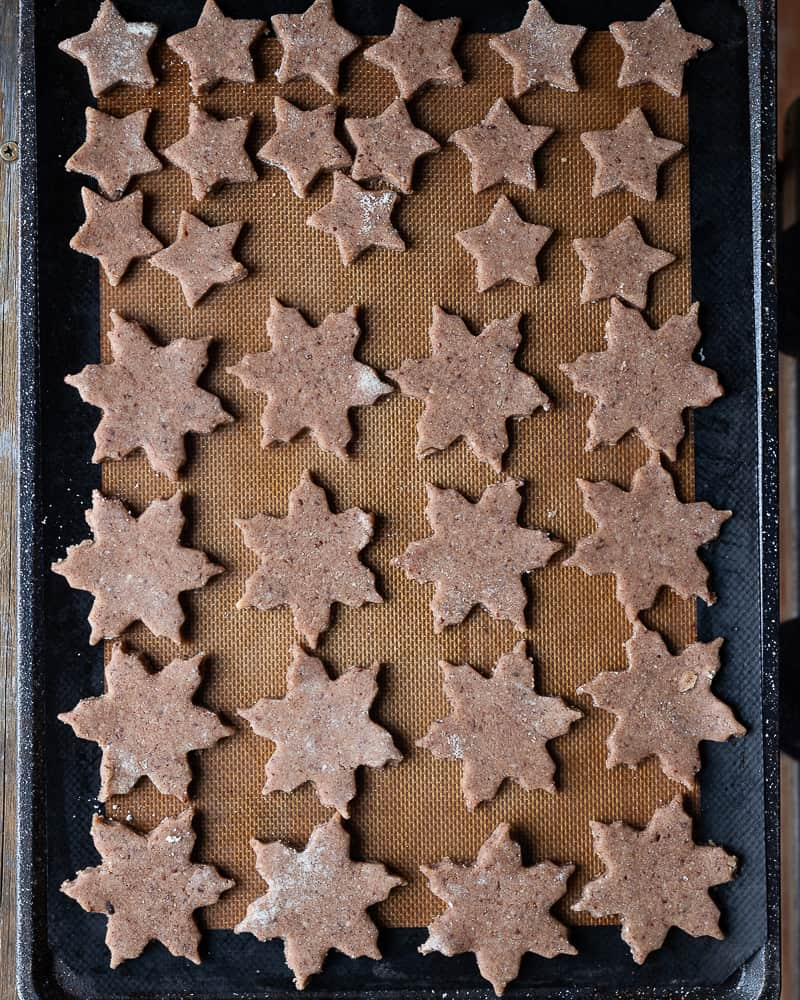Cookie stars on a baking sheet ready to be baked