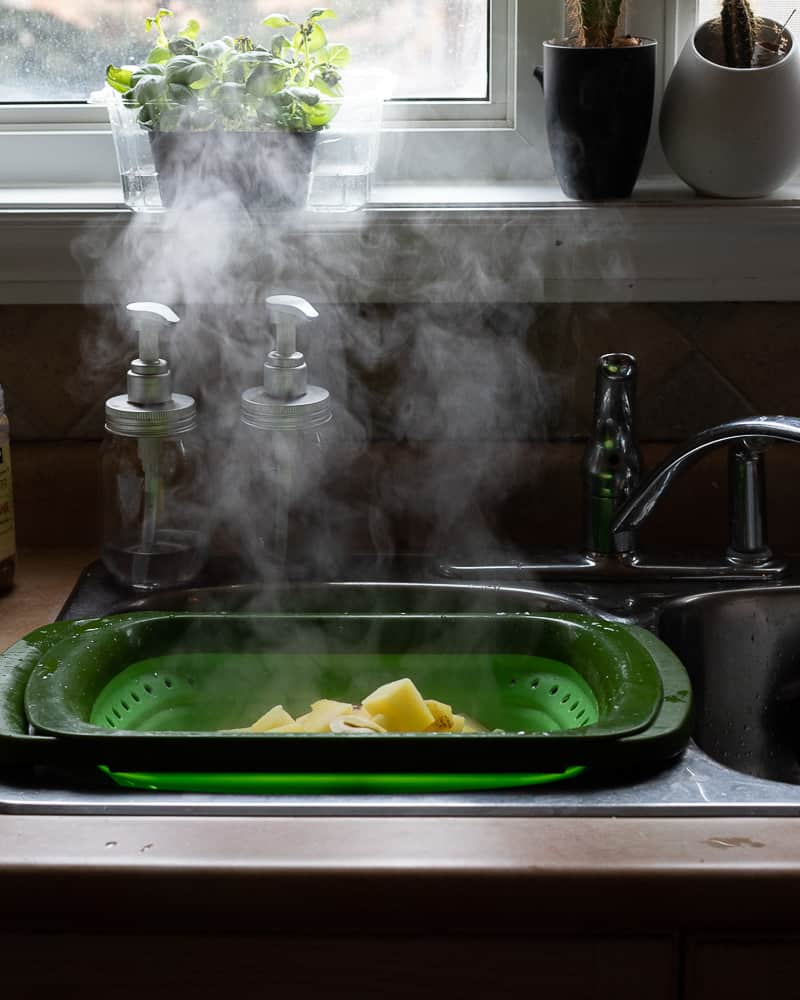 steam rising from cooked potatoes